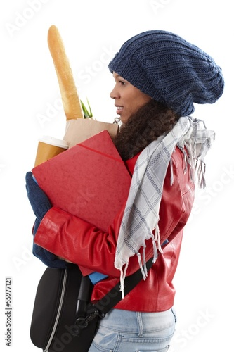 Overloaded woman with full hands at winter