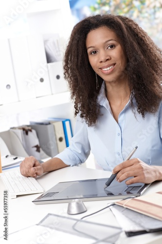 Smiling businesswoman with drawing pad