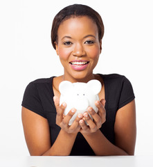 young african american woman holding piggy bank