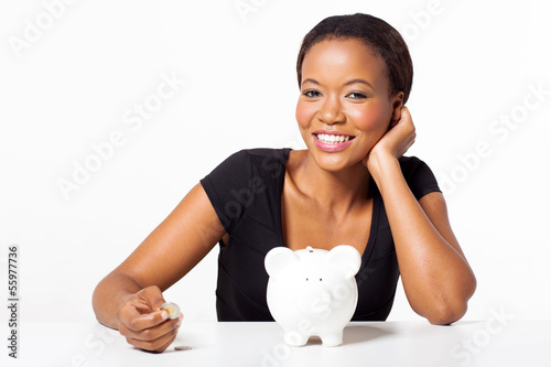 beautiful african woman holding coin