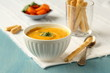 Bowl of homemade carrot soup with coconut milk and coriander