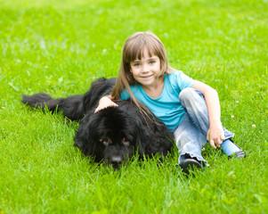 Girl with Newfoundland dog