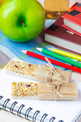 Healthy school lunch for kids with stick berry muesli and green
