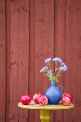 summer apple and blue vase with flowers