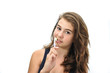 pretty smiling teen brushing her teeth isolated on white