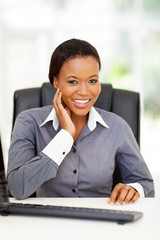 african american businesswoman sitting in office