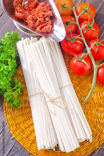raw pasta and  tomato and sauce