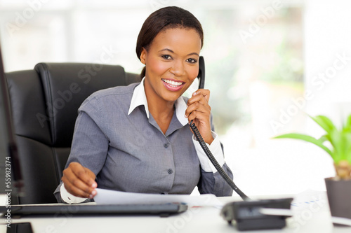 female african office worker talking on phone