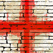 Grunged English Cross of Saint George Flag over a brick wall