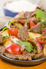 Lomo Saltado - Traditional Peruvian beef stir-fry.