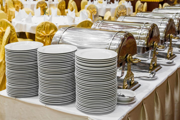 Dishes and warming trays for buffet line