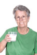 old woman holding a glass of milk