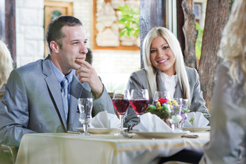 blonde businesswoman in restaurant