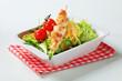 Chicken skewer with salad greens