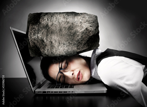 Woman with laptop having stress.