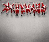 Christmas Santa hanging on rope.