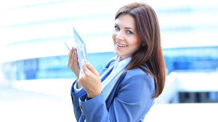 Businesswoman working on digital tablet outdoor