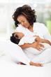 african american mother holding sleeping little baby