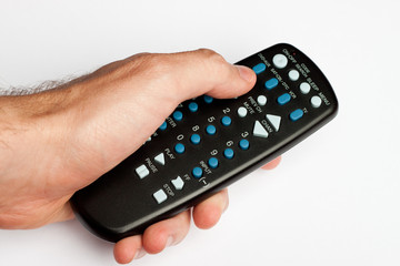 Hand holding a black TV remote