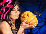 Witch holding pumpkin