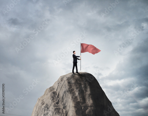 businessman with red  flag