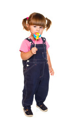 Cute little girl eating a colored lollipop