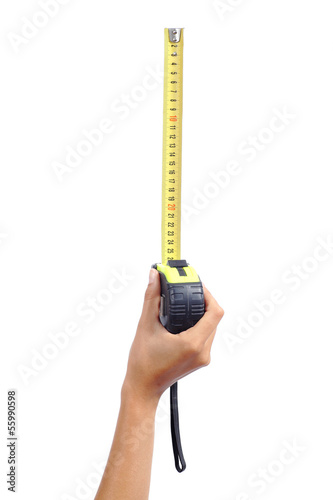 Woman hand holding a metallic tape measure