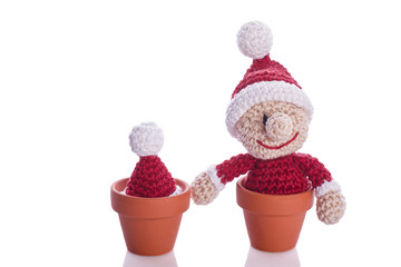 two christmas gnome in a plant pot decoration