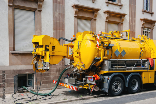 Sewerage truck on city street working
