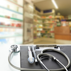 Stethoscope with black medical clipboard