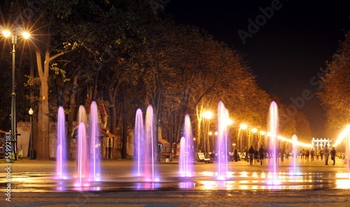 Fotobehang Fontaine Colored water fountain at night. Ukraine. Kharkov. Gorky Park.