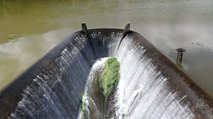 Water flowing from dam. lake.