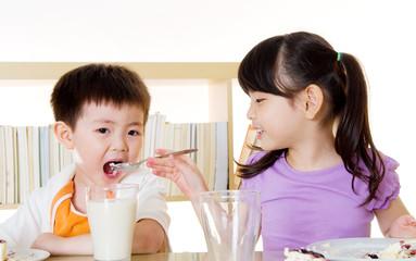 Asian kids eating