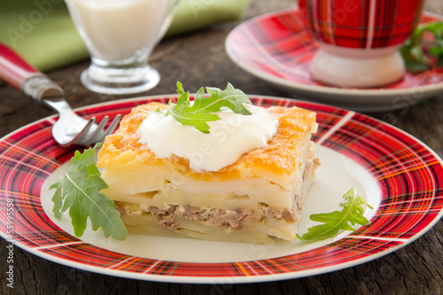Potato gratin with cheese and meat.