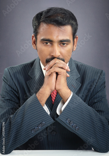 indian young businessman praying