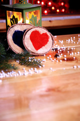 Two wooden hearts in a romantic christmas atmosphere