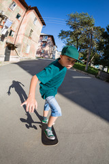 Boy riding a skateboard on the street.