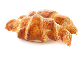 Croissants close-up isolated on white background