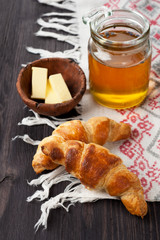 Croissants with honey in a rustic style