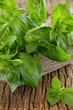 Bunch of basil on the old board. Selective focus.