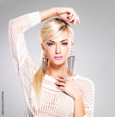 beautiful woman with fashion makeup and long white hairs