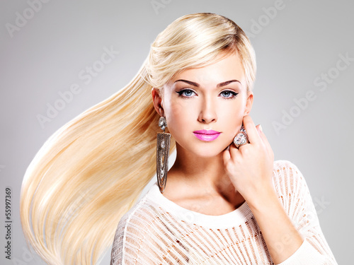 Beautiful woman with long  hairs and fashion makeup.
