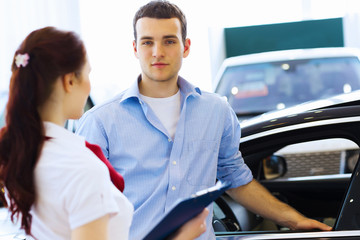 Young man at car salon