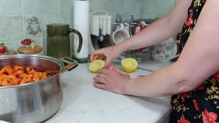 In the Polish kitchen. Preparing a delicious apricot jam.