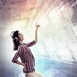 Woman touching virtual screen