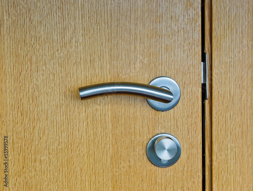 Modren style door handle on wooden door