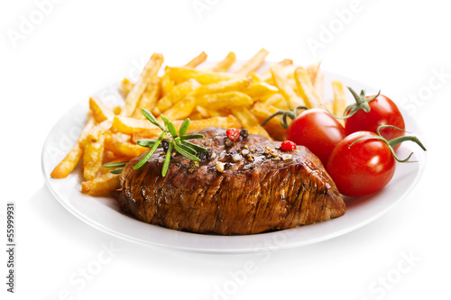 plate of grilled meat with french fries