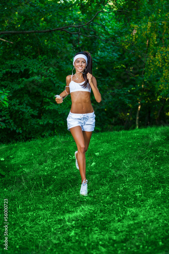 young beautiful brunette sportswoman outdoor