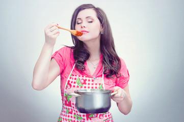 a woman taste sauce