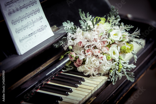 Bridal bouquet on the piano close-up